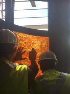 Installing the cast glass pane into the reredos at Church of the Resurrection